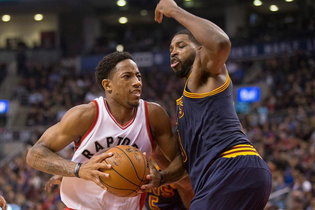 . Toronto Raptors guard DeMar DeRozan, left, drives on Cleveland Cavaliers forward Tristan Thompson during the first half of an NBA basketball game in Toronto on Friday, Oct. 28, 2016. (Chris Young/The Canadian Press via AP)