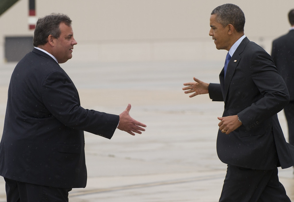. US President Barack Obama shakes hands with New Jersey Governor Chris Christie (L) after arriving at Joint Base McGuire-Dix in New Jersey on May 28, 2013.  AFP PHOTO / Saul LOEB/AFP/Getty Images