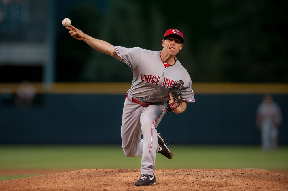 . Dylan Axelrod #40 of the Cincinnati Reds pitches against the Colorado Rockies in the first inning during the second game of a split double header at Coors Field on August 17, 2014 in Denver, Colorado.  (Photo by Dustin Bradford/Getty Images)