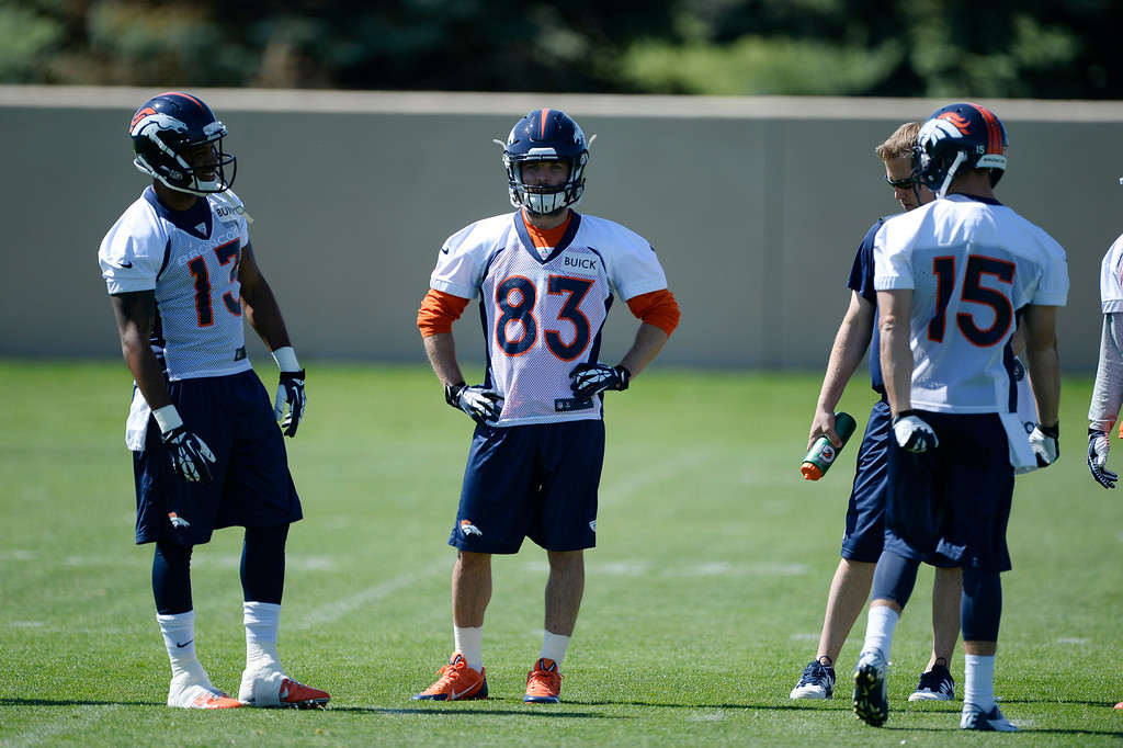 . Denver Broncos wide receivers Nathan Palmer (13) Wes Welker (83) watch drills during OTAs  June 2, 2014 at Dove Valley. (Photo by John Leyba/The Denver Post)