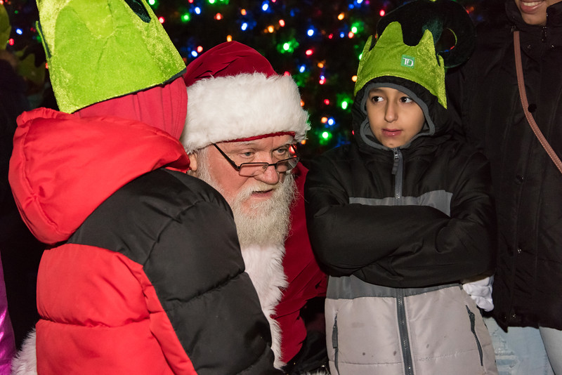 11/29/18  Wesley Bunnell | Staff   New Britain held their tree lighting ceremony with a visit from Santa on Thursday evening at Central Park. Joseph Filipkowski, age 11, looks on as his brother Jordan, age 7 L, tells Santa Claus his Christmas gift wishes.