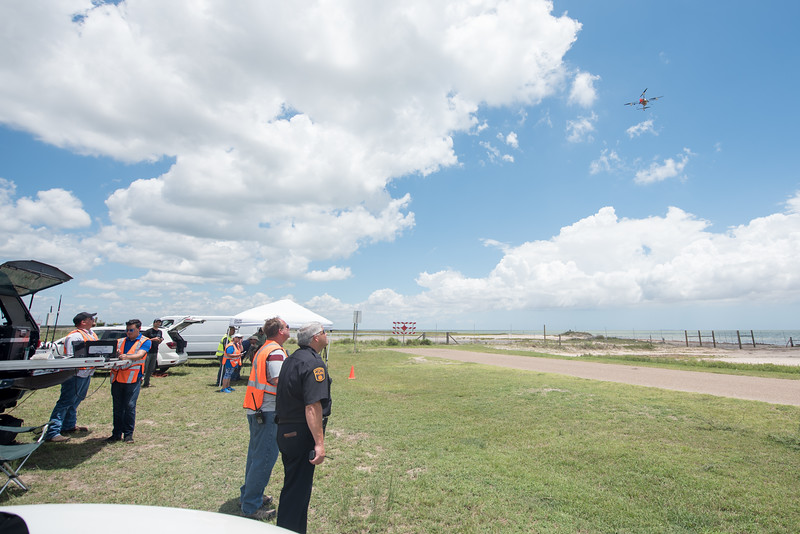 Lone Star UAS and the Port Mansfield police department work watch as a drone takes off during the UTM demonstration.