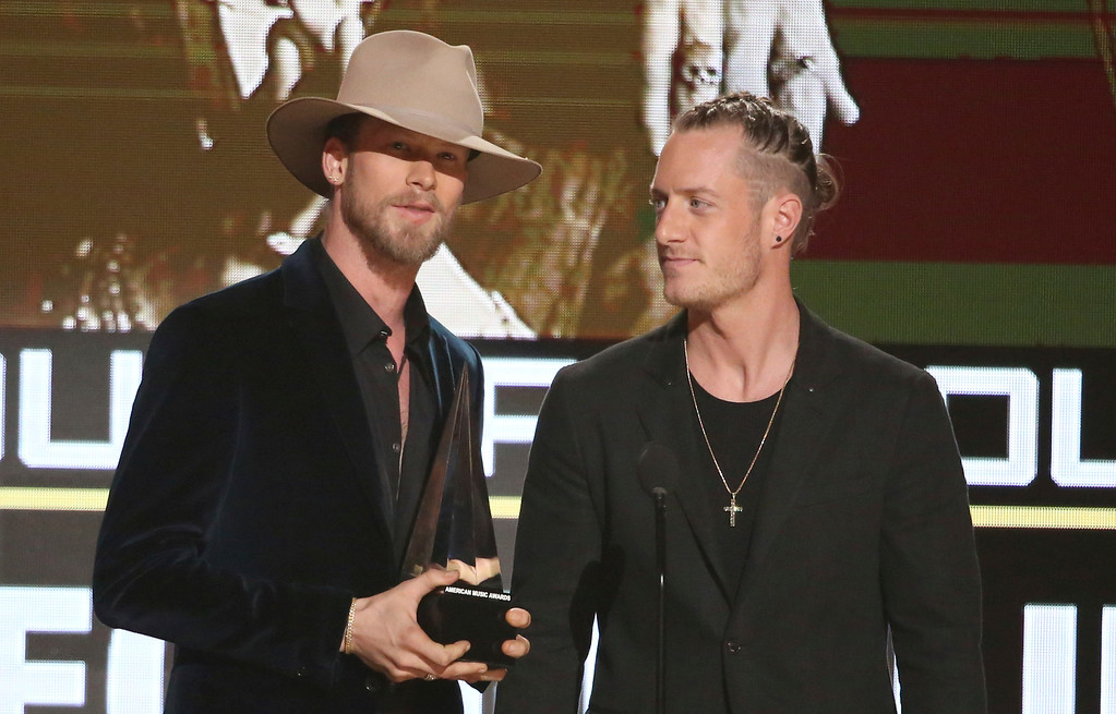 . Brian Kelley, left, and Tyler Hubbard, of Florida Georgia Line, accept the award for favorite country duo/group at the American Music Awards at the Microsoft Theater on Sunday, Nov. 20, 2016, in Los Angeles. (Photo by Matt Sayles/Invision/AP)
