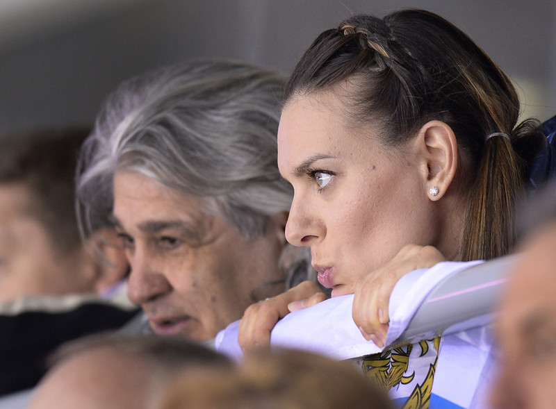 . Russian pole vault superstar Yelena Isinbayeva attends the Men\'s Ice Hockey play-offs qualification match Russia vs Norway at the Bolshoy Ice Dome during the Sochi Winter Olympics on February 18, 2014.  (ALEXANDER NEMENOV/AFP/Getty Images)