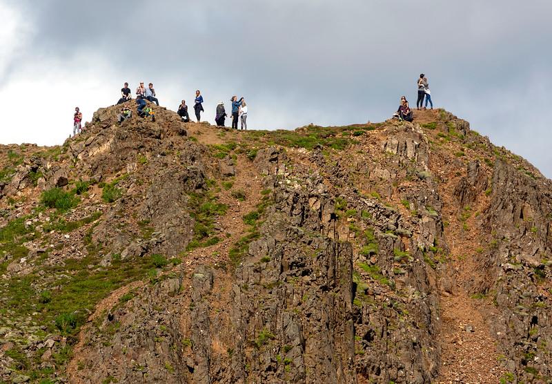 Geysir watchers on a nearby mountain