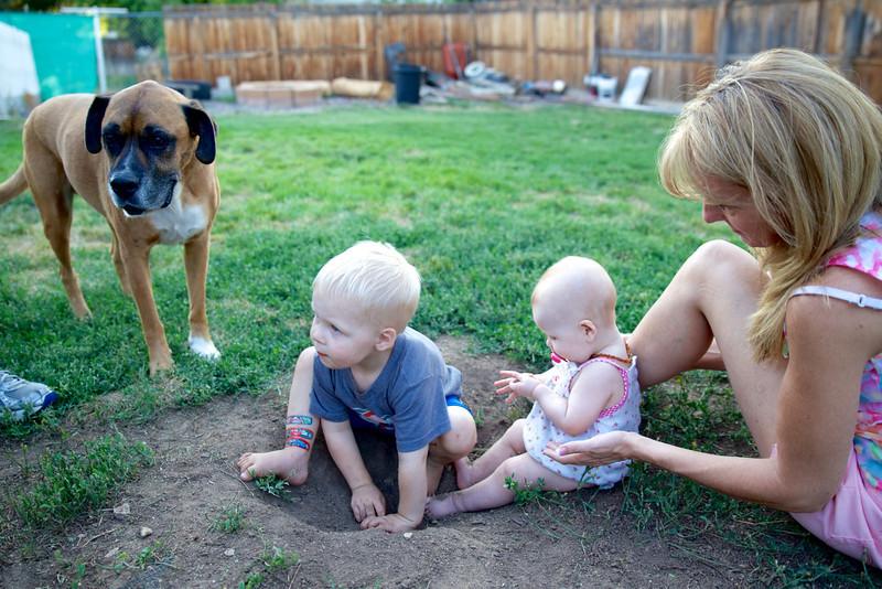 Kadin & Makenzie playing in the dirt with Grandma & Max