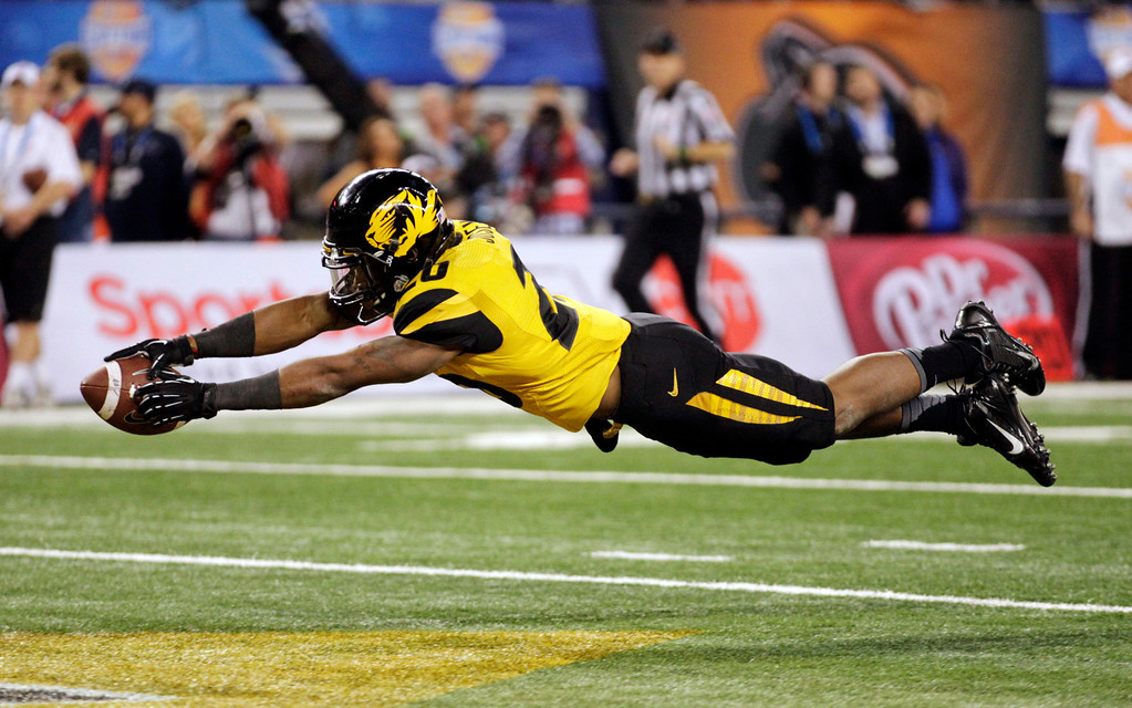 . Missouri running back Henry Josey (20) goes in for a touchdown against Oklahoma State during the second half of the Cotton Bowl NCAA college football game on Friday, Jan. 3, 2014, in Arlington, Texas.  (AP Photo/Tim Sharp)