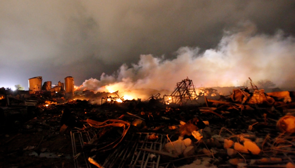 Description of . The remains of a fertilizer plant burn after an explosion at the plant in the town of West, near Waco, Texas early April 18, 2013. The deadly explosion ripped through the fertilizer plant late on Wednesday, injuring more than 100 people, leveling dozens of homes and damaging other buildings including a school and nursing home, authorities said.  REUTERS/Mike Stone
