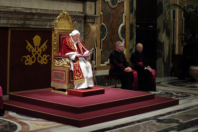 """. This handout picture released by the Vatican Press Office on February 28, 2013 shows Pope Benedict XVI (C) delivering a speech to cardinals in the Vatican\'s ornate Clementine Hall at the Vatican. Pope Benedict XVI vowed \""""unconditional obedience\"""" to his successor on his historic final day as leader of the world\'s 1.2 billion Catholics, when he will become the first pontiff to resign since the Middle Ages.  OSSERVATORE ROMANO\""""-/AFP/Getty Images"""