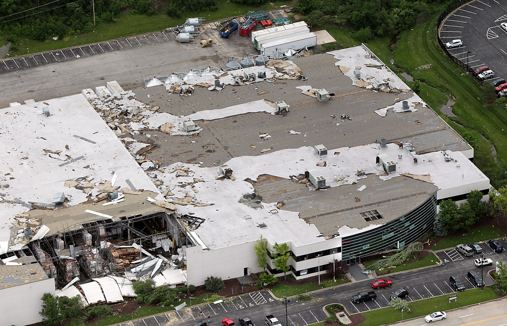 . A distribution warehouse in the Earth City corridor was heavily damaged during a storm, Saturday, June 1, 2013 in St. Charles County, Mo. The National Weather Service confirms at least two tornados were part of the Friday night storm that raked portions of the St. Louis area, damaging hundreds of homes but causing no serious injuries. (AP Photo/St. Louis Post-Dispatch, Robert Cohen)