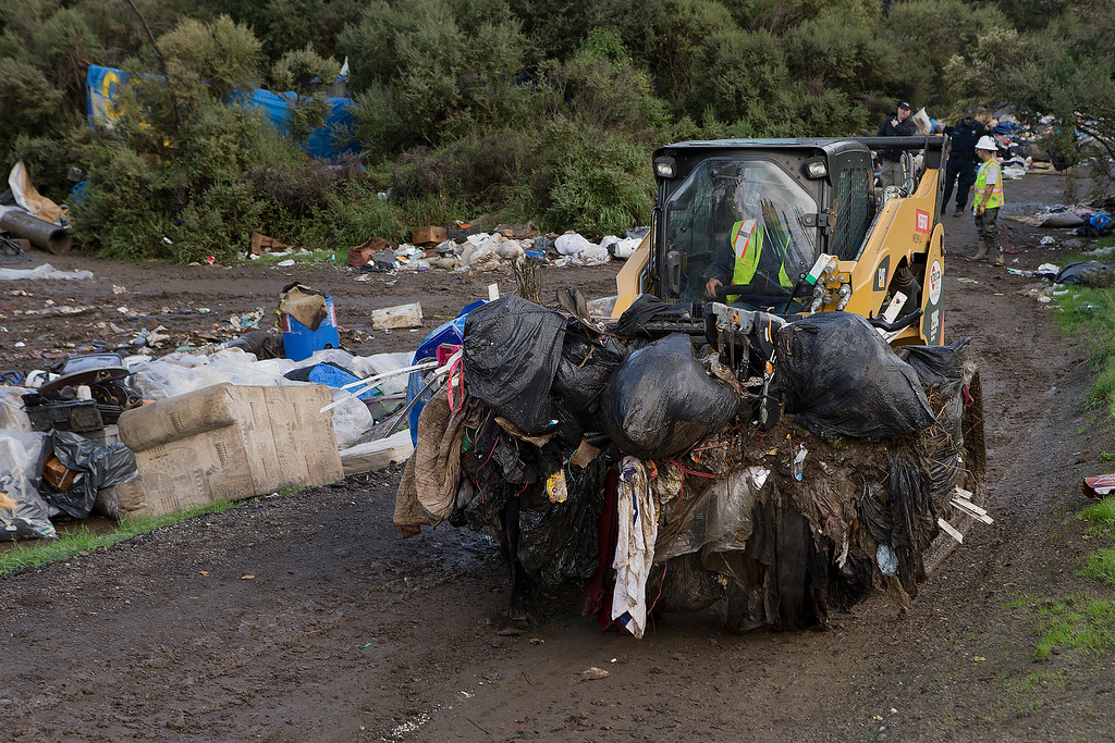 . Workers from Tucker Construction clear campsites in the homeless encampment known as The Jungle in San Jose, Calif., on Thursday, Dec. 4, 2014. (LiPo Ching/Bay Area News Group)