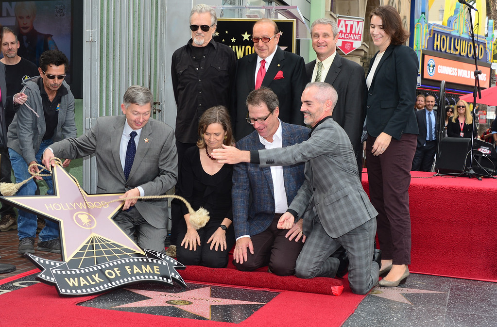 """. Siblings of the late Janis Joplin, Laura and Michael(sitting center), attend her posthumous Hollywood Star ceremony where Kris Kristofferson(back-sunglasses) performed \""""Me & Bobby McGee\"""", on November 4, 2013 in Hollywood, California. Joplin, would have turned 70 years old this year and is the recipient of the 2,510th Star on the Hollywood Walk of Fame in the Category of Recording.      (FREDERIC J. BROWN/AFP/Getty Images)"""