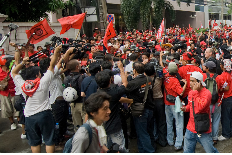 Media personnel gathering for an interview during Red Shirt Protest