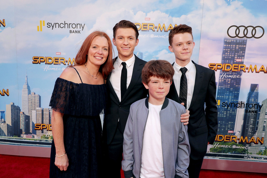 """. Nicola Elizabeth Frost, Tom Holland, Sam Holland and Harry Holland seen at Columbia Pictures World Premiere of \""""Spider-Man: Homecoming\"""" at TCL Chinese Theatre on Wednesday, June 28, 2017, in Hollywood, CA. (Photo by Eric Charbonneau/Invision for Sony Pictures/AP Images)"""