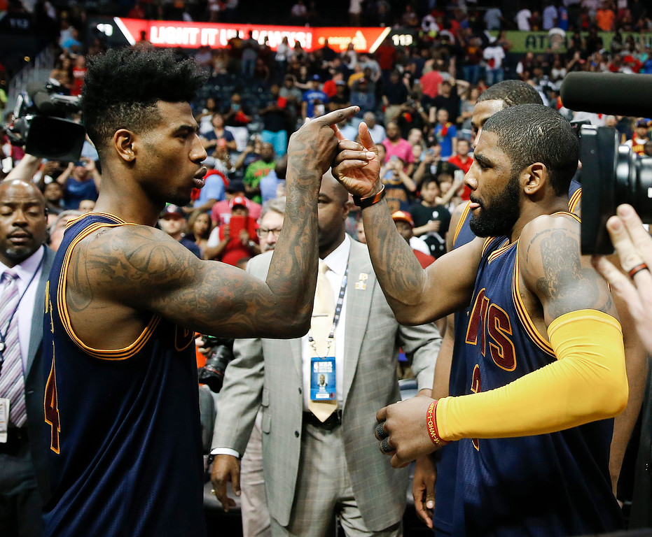 . Cleveland Cavaliers guard Iman Shumpert (4), left, and Cleveland Cavaliers guard Kyrie Irving (2) celebrate after defeating the Atlanta Hawks in Game 4 of the second-round NBA basketball playoff series, Sunday, May 8, 2016, in Atlanta. Cleveland won 100-99 and won the best-of-seven series 4-0. (AP Photo/John Bazemore)