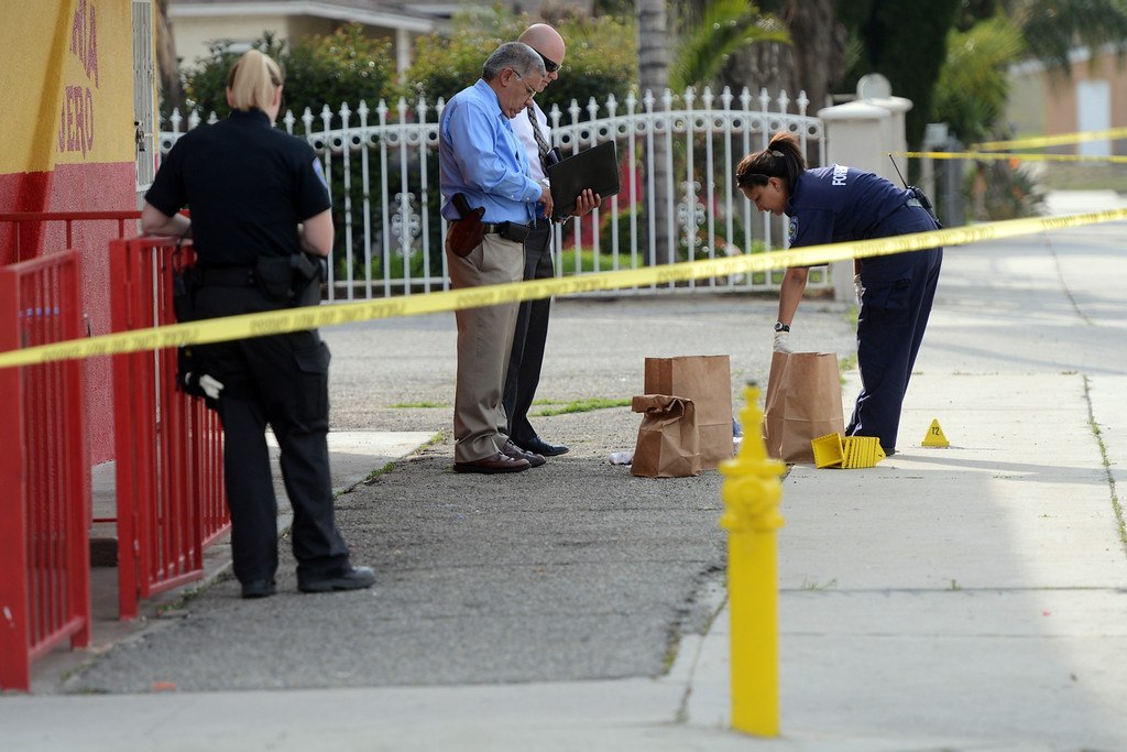 . San Bernardino Police officials investigate the scene of a shooting at Medical Center Drive and Union Street in San Bernardino, CA, Wednesday, March 5, 2014. (Photo by Jennifer Cappuccio Maher/Inland Valley Daily Bulletin)