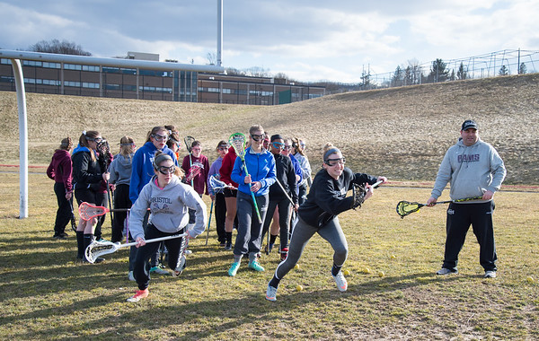 03/18/19 Wesley Bunnell | Staff The Bristol Central girls lax team runs drills on Monday after school. Seniors Erika Santilli, L, competes against fellow Senior Jade Longo as coach Kyle Phalen looks on.