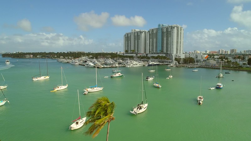 Aerial drone video Miami Beach sail boats Sunset Harbour