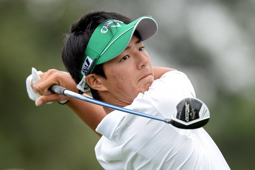 Description of . Ryo Ishikawa of Japan hits a tee shot on the 10th hole during the final round of the 2013 Masters Tournament at Augusta National Golf Club on April 14, 2013 in Augusta, Georgia.  (Photo by Harry How/Getty Images)