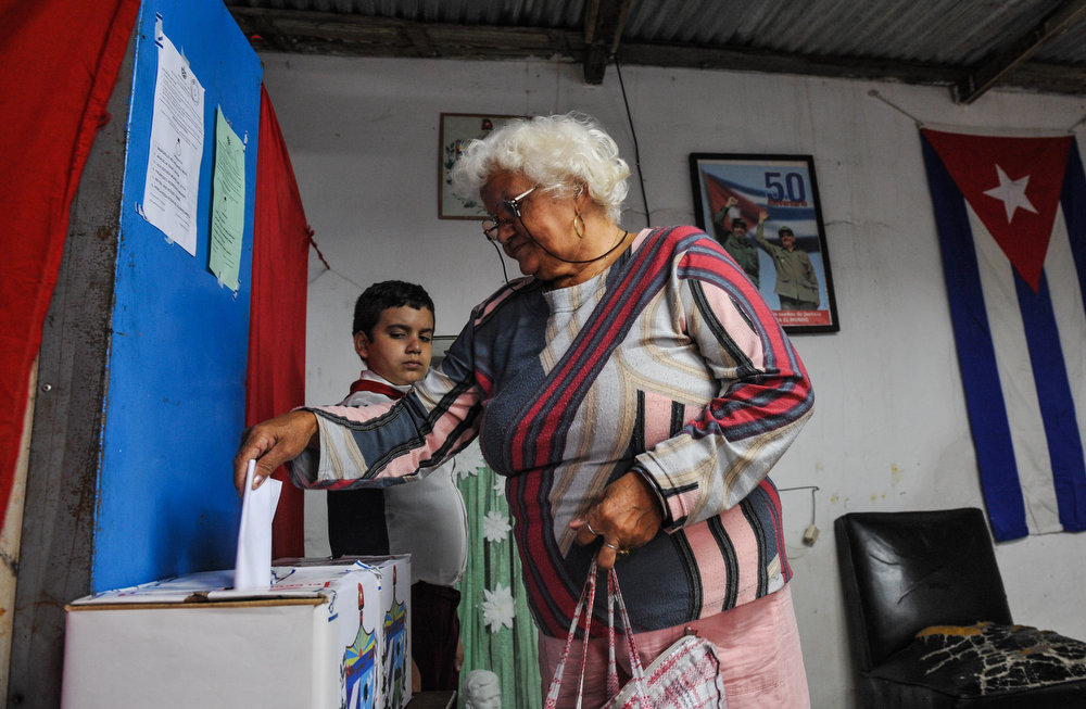 . A Cuban casts her vote at a polling station in Havana on February 3, 2013. Cubans on Sunday elected provincial delegates to to the People\'s Power assemblies and parliamentary deputies.  AFP PHOTO / STR/AFP/Getty Images