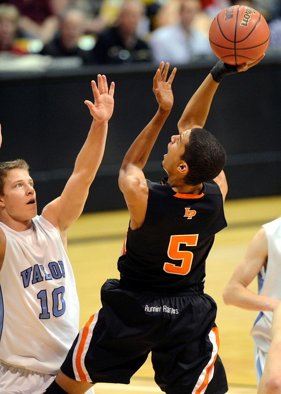 . BOULDER, CO. - MARCH 16: Rangers forward Jordan Scott (5) lofted a shot over Valor defender Christian McCaffrey (10) in the first half. Lewis Palmer-High School boy\'s basketball team met Valor Christian in the 4A championship game Saturday, March 16, 2013 at the Coors Events Center in Boulder.  (Photo By Karl Gehring/The Denver Post)