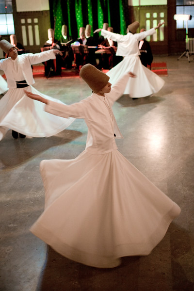 Istanbul, Turkey - January, 2008: The brotherhood of followers of Rumi known as Mevlevi or Whirling Dervishes perform their distinctive religious ceremony in Istanbul, Turkey. Rumi is famous for his poetry and religious writing and lived in the 13th century. (photo by: Christopher Herwig)