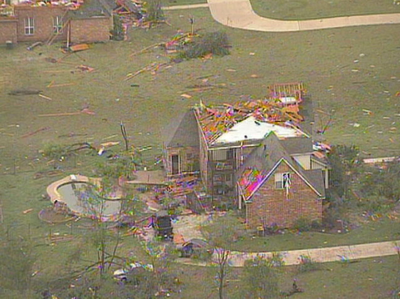 . An aerial image from KXAS-NBC5 Dallas-Ft Worth video footage shows tornado damage left behind in Hood County, Texas, May 16, 2013. At least six people were killed and scores more injured when tornadoes ripped through a stretch of Texas near Dallas-Fort Worth after dark on Wednesday, destroying homes and uprooting trees, authorities said.  REUTERS/Courtesy of KXAS-NBC5 Dallas-Ft Worth via Reuters
