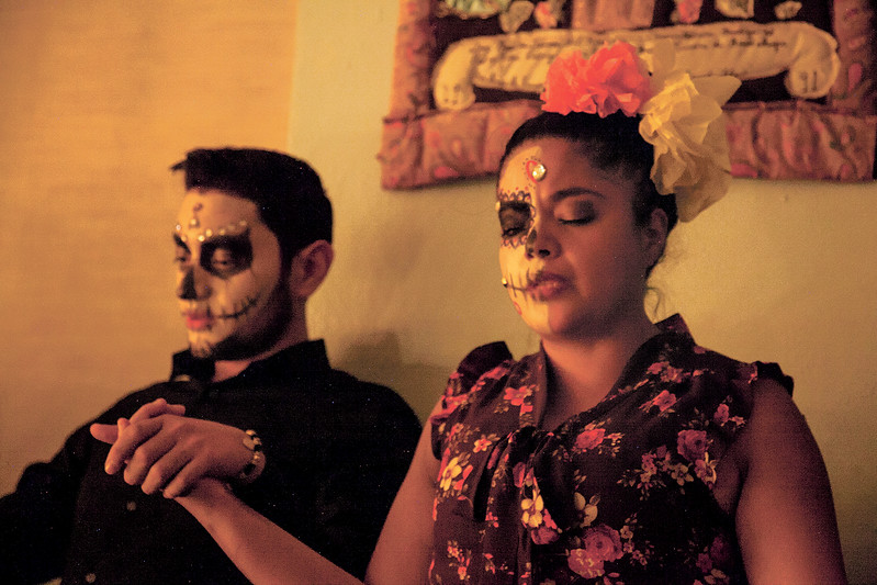 Rafael Saenc and Ramona Galdo hold hands in prayer to close their Dia de Los Muertos celebration on November 3, 2017 at Our Lady of Guadalupe Church. Gabriela Campos/The New Mexican