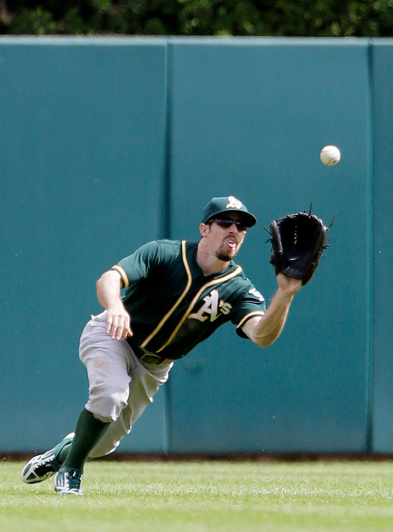 . Oakland Athletics center fielder Billy Burns makes the catch on a fly ball hit by Detroit Tigers\' Nick Castellanos during the ninth inning of a baseball game at Comerica Park, Thursday, June 4, 2015, in Detroit. The Athletics defeated the Tigers 7-5. (AP Photo/Duane Burleson)