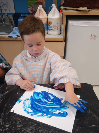 Finger painting with Primary Colors in Pre-K M