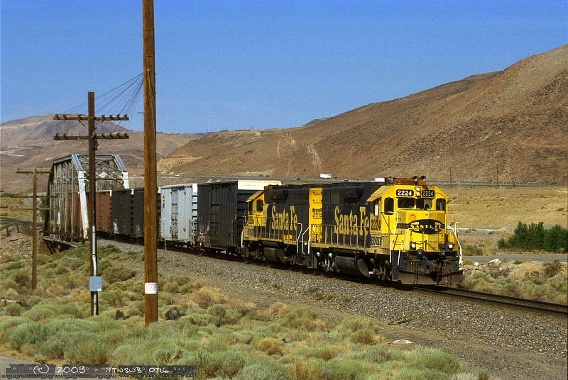 BNSF's local with two bluebonnet GP38s races eastbound out of Reno, NV.