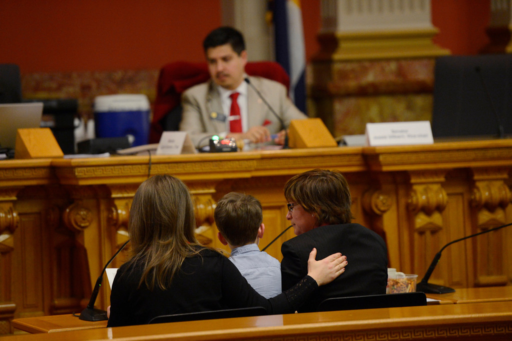 . Denver, CO. - January 23: Five-year-old Jeremy Simon sits between his two moms Anna and Fran as the family gives testimony to the Senate Judiciary Committee on Senate Bill 11 at the Denver State Capitol. The bill would allow gay couples to form civil unions.   Denver, Colorado January 23, 2013. (Photo By Joe Amon / The Denver Post)