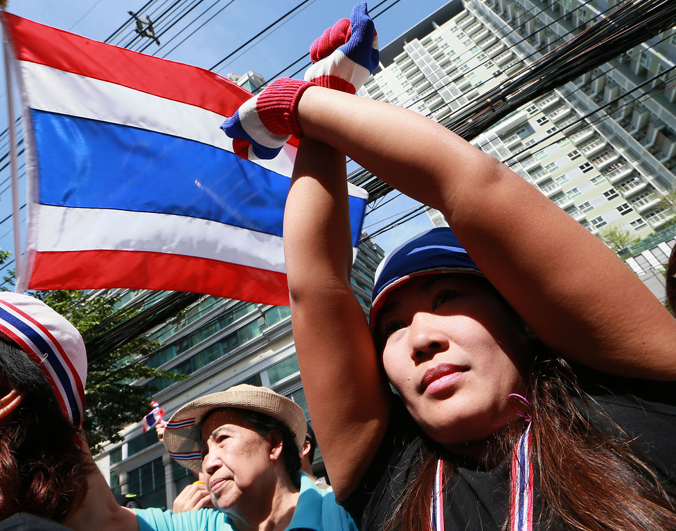 . An anti-government protester crosses her arms as a gesture of her opposition to the government outside the headquarters of Prime Minister Yingluck Shinawatra\'s ruling Pheu Thai Party in Bangkok, Thailand, Friday, Nov. 29, 2013. (AP Photo/Wason Wanichakorn)