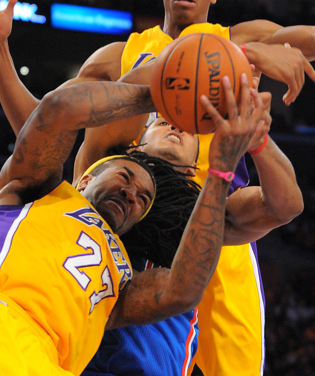 . Lakers Jordan Hill wrestles for a rebound against Clippers Ryan Hollins in the NBA season opener between the Lakers and Clippers at Staples Center in Los Angeles, CA on Tuesday, October 29, 2013.   (Photo by Scott Varley, Daily Breeze)