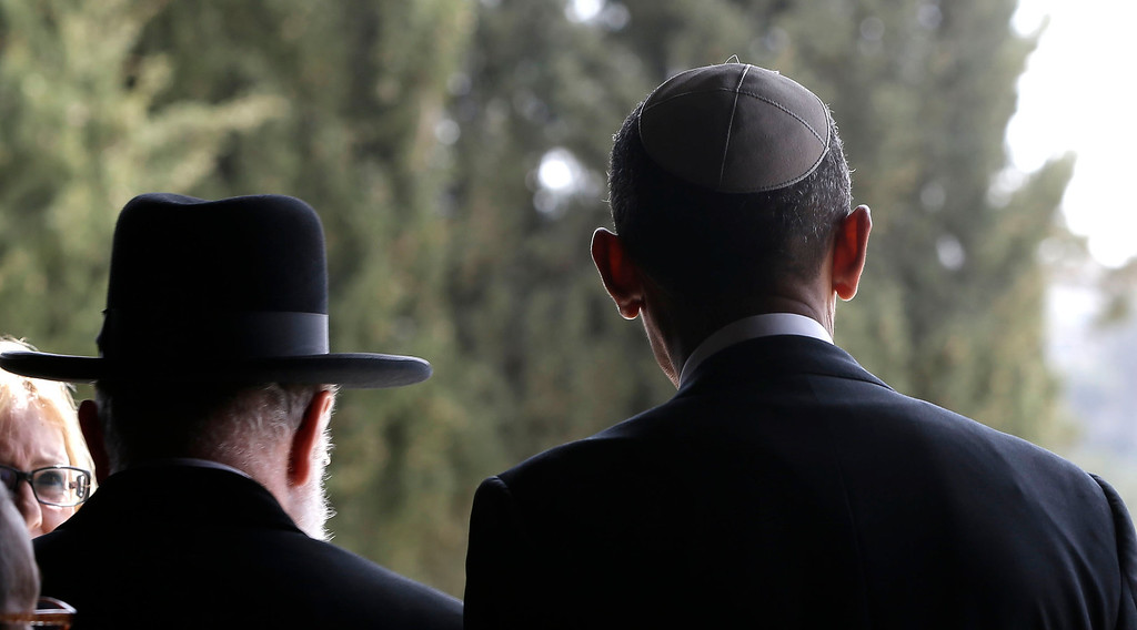 . U.S. President Barack Obama, right, walks out with Rabbi Meir Lau, left, after visiting the Hall of Remembrance at the Vad Vashem Holocaust Memorial in Jerusalem, Israel, Friday, March 22, 2013. (AP Photo/Pablo Martinez Monsivais)