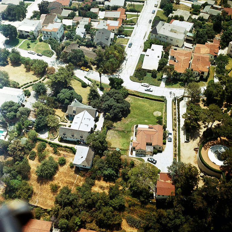 . An aerial view of the home of Mr. and Mrs. Leno A. LaBianca, who were found slain on August 10 in the Los Feliz district of Los Angeles, is seen on Aug 13, 1969. Some aspects of the slayings were similar to those in the murders of actress Sharon Tate and four others in the city\'s Bel-Air district 10 miles to the west. (AP Photo)