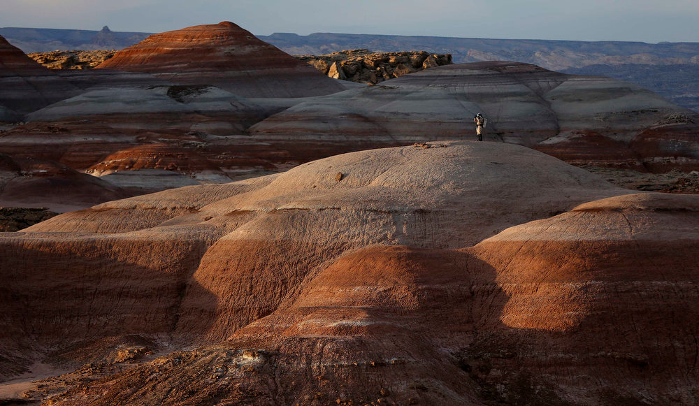 . Volker Maiwald, executive officer and habitat engineer of Crew 125 EuroMoonMars B mission, walks among the rock formations while collecting geologic samples for study at the Mars Desert Research Station (MDRS) in the Utah desert March 2, 2013.  REUTERS/Jim Urquhart
