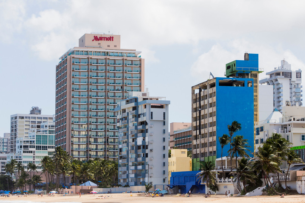 . Vacant buildings dot the coast in the upscale Condado neighborhood on November 12, 2013 in San Juan, Puerto Rico. The island territory of the United States, Puerto Rico, is on the brink of a debt crisis as lending has skyrocketed in the last decade as the government has been issuing municipal bonds. Market analysts have rated those bonds as junk and suspect it\'s 70 billion dollar debt might be unserviceable in the near future. With no industry other than tourism and the recent collapse of the real estate market, the way out is unclear. (Photo by Christopher Gregory/Getty Images)
