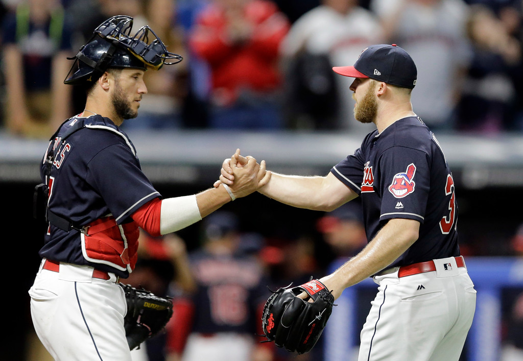 . Cleveland Indians\' Yan Gomes, left, celebrates with Cleveland Indians relief pitcher Cody Allen after the Indians defeated the Tampa Bay Rays 8-7 in a baseball game, Monday, May 15, 2017, in Cleveland. (AP Photo/Tony Dejak)
