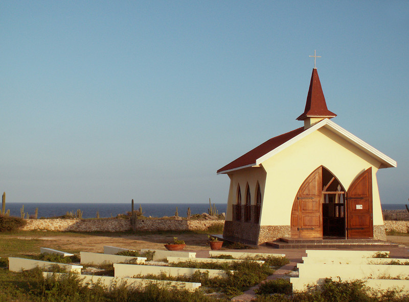 Built in 1750, abandoned in the 1800's and rebuilt 200 yrs. later, the Alto Vista Chapel radiates serenity from its cactus-studded perch overlooking the sea.  This was Aruba's first chapel, built by the Caiquetio Indians and Spanish settlers before the island had its own priest.  Secluded and hugging the northeastern coast, the bright yellow structure rests at the end of a winding road lined with white crosses.