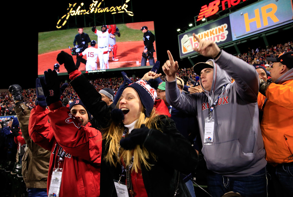 . BOSTON, MA - OCTOBER 24:  Fans react after David Ortiz #34 of the Boston Red Sox hit a two run home run in the sixth inning against the St. Louis Cardinals during Game Two of the 2013 World Series at Fenway Park on October 24, 2013 in Boston, Massachusetts.  (Photo by Jamie Squire/Getty Images)
