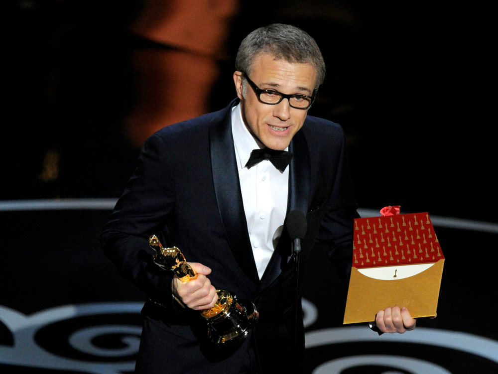 Description of . Actor Christoph Waltz accepts the award for best actor in a supporting role for