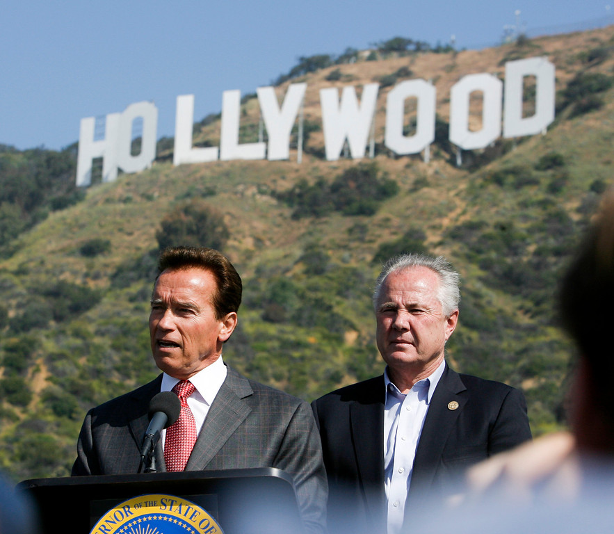 . Governor Arnold Sxhwarzenegger and  Los Angeles City Councilmember Tom LaBonge at a press conference Monday to announce that a $900,000 donation from Hugh Hefner and the Playboy Foundation have bridged the gap to save 138 acres near the sign from developers.  The parcel of land will be preserved and annexed to Griffith Park.  4/26/2010 (David Crane/Los Angeles Daily News)