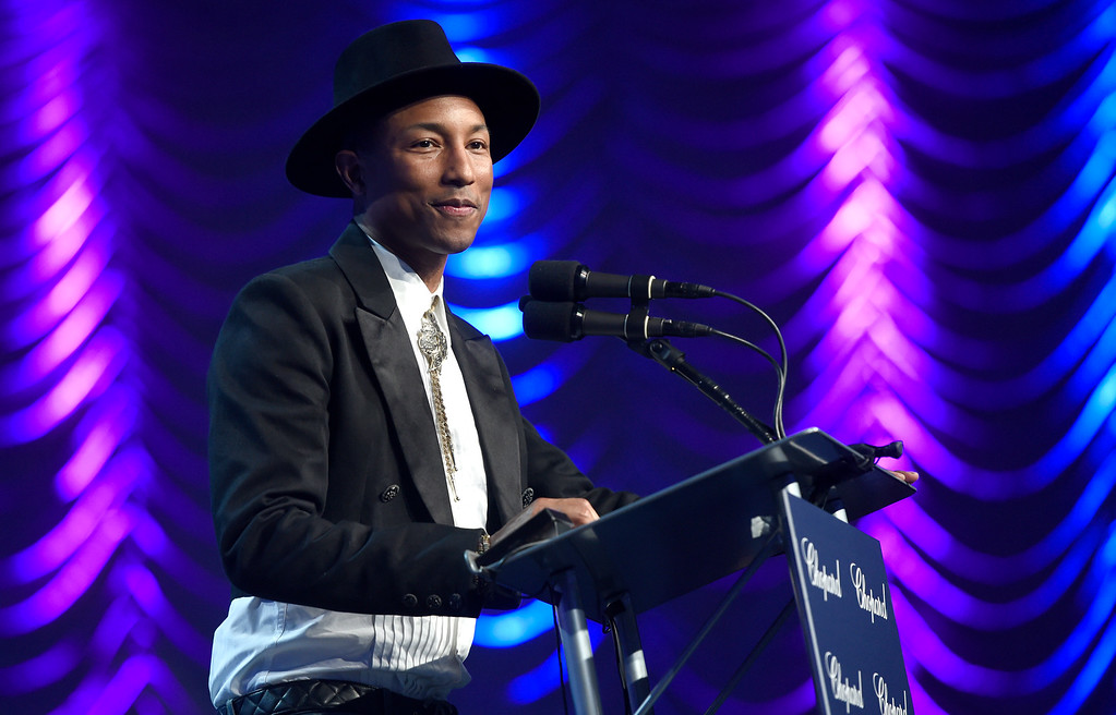 ". Pharrell Williams presents the award for ensemble performance to the cast of ""Hidden Figures\"" at the 28th annual Palm Springs International Film Festival Awards Gala on Monday, Jan. 2, 2017, in Palm Springs, Calif. (Photo by Chris Pizzello/Invision/AP)"