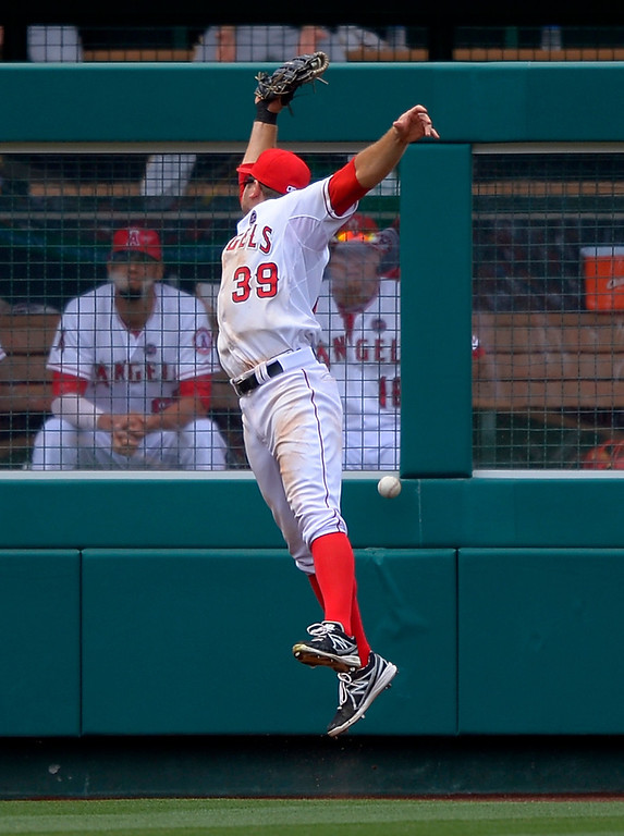 . Los Angeles Angels left fielder J.B. Shuck can\'t reach a ball hit for an RBI double by Pittsburgh Pirates\' Russell Martin during the ninth inning of their baseball game, Sunday, June 23, 2013, in Anaheim, Calif.  (AP Photo/Mark J. Terrill)