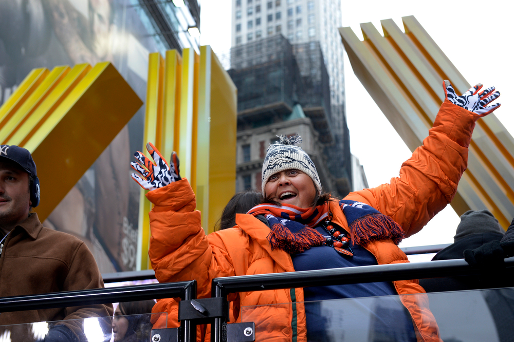 ". Karin Cambria, of Denver, has her picture made at Times Square in New York, NY January 31, 2014. The NFL has transformed 13 blocks of Broadway into Super Bowl Boulevard before Sundays Super Bowl between the Denver Broncos and Seattle Seahawks. She said, ""it\'s going to be close but the Broncos are gonna pull it off.\""  (Photo By Craig F. Walker / The Denver Post)"