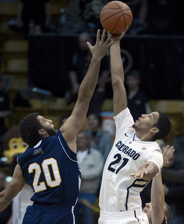 . University of Colorado\'s Andre Roberson wins the tip off against Gaellan Bewernick during a game against Northern Arizona on Friday, Dec. 21, at the Coors Event Center on the CU campus in Boulder.    (Jeremy Papasso/Daily Camera)