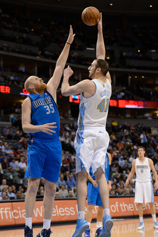. DENVER, CO. - APRIL 04: Kosta Koufos (41) of the Denver Nuggets takes a jump hook shot over Chris Kaman (35) of the Dallas Mavericks during the first quarter April 4,  2013 at Pepsi Center. (Photo By John Leyba/The Denver Post)