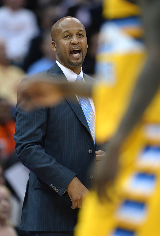 . DENVER, CO. - JANUARY 03:  Denver coach Brian Shaw called in some instructions from the bench. The Denver Nuggets hosted the Memphis Grizzlies at the Pepsi Center Friday night, January 3, 2014. Photo By Karl Gehring/The Denver Post