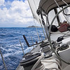 View from onboard a luxury sailboat sailing through the tropics.